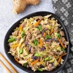 Instant Pot Egg Roll in a Bowl is a delicious low carb one pot recipe. It is a simple meat and cabbage dish with a tasty Asian flavored sauce. This pressure cooker egg roll in a bowl is also known by the name Crack Slaw. Instant Pot recipes by simplyhappyfoodie.com #instantpoteggrollinabowl #instantpotcrackslaw #crackslaw