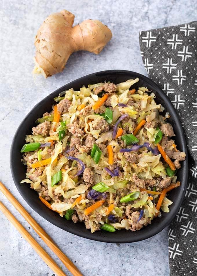 Instant Pot Egg Roll in a Bowl is a delicious one pot recipe that happens to be low carb. It is a simple dish with pork, cabbage, carrots, and a tasty Asian flavored sauce. This pressure cooker egg roll in a bowl is also known by the name Crack Slaw.