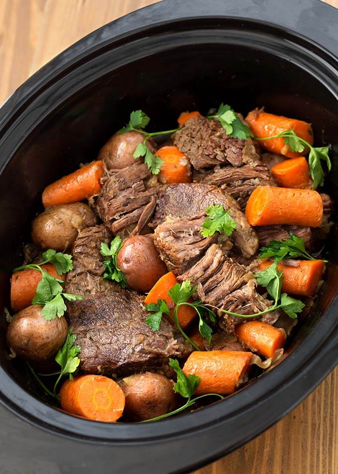 Top view of Pot Roast with vegetables in a slow cooker