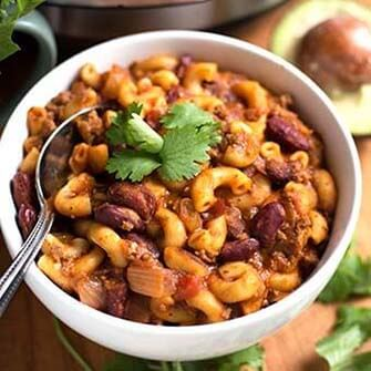 chili mac with a silver spoon in a white bowl