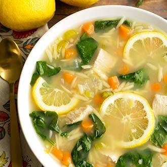 instant pot lemon chicken orzo soup in a white bowl