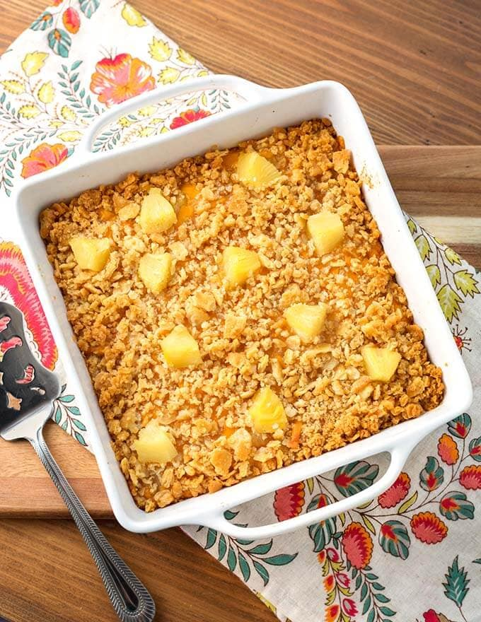 Pineapple Casserole in square white baking dish