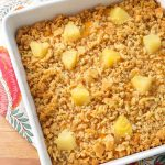 Southern Pineapple Casserole in a white square baking dish