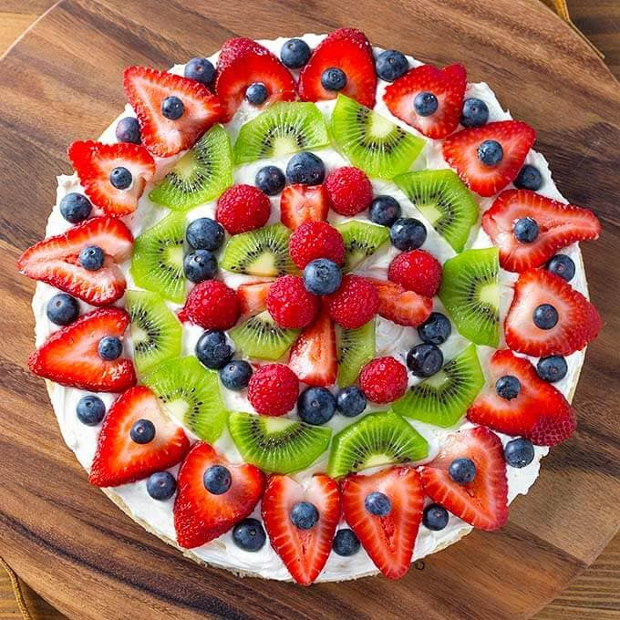 Whole Fresh Fruit Pizza on a wooden board