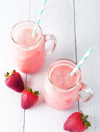 Two Strawberry Sunshine Smoothies with straws