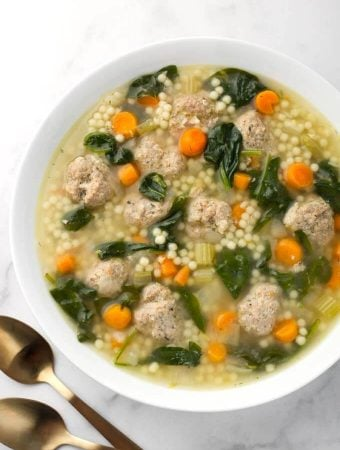 Instant Pot Italian Wedding Soup in white bowl next to two spoons