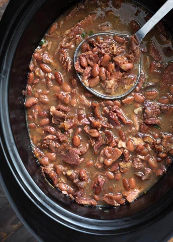 Pinto Beans and Ham in slow cooker with ladle