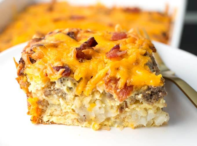 Slice of Tater Tot Breakfast Casserole on a white plate