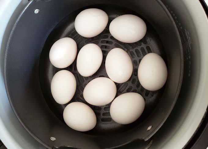 uncooked eggs in air fryer basket