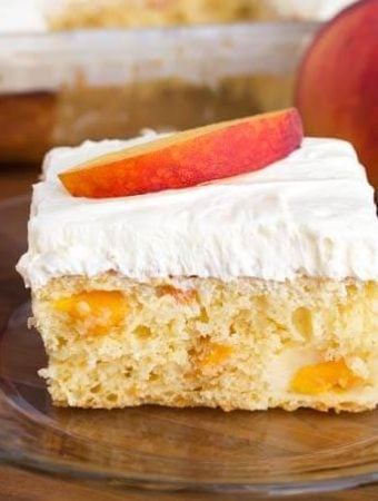 Slice of Easy Peach Potluck Cake on glass plate