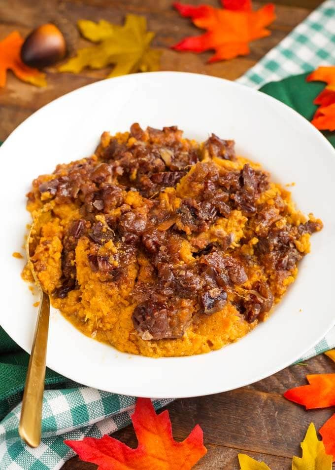 Slow Cooker Creamy Sweet Potatoes on a white plate with golden spoon