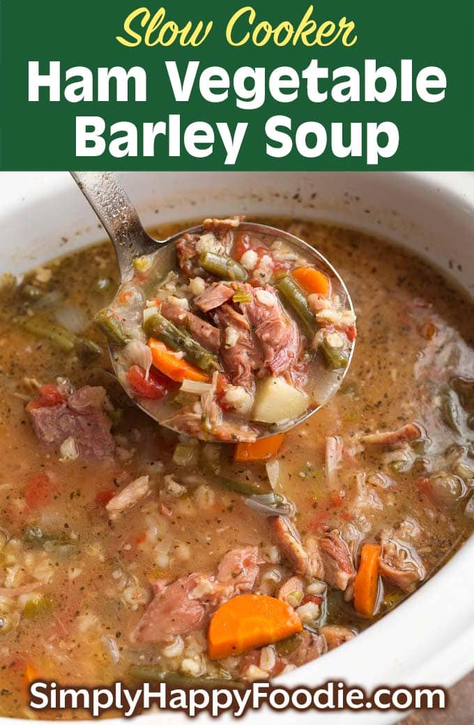 Slow Cooker Ham Vegetable Barley Soup in white bowl as well as title and Simply Happy Foodie.com logo