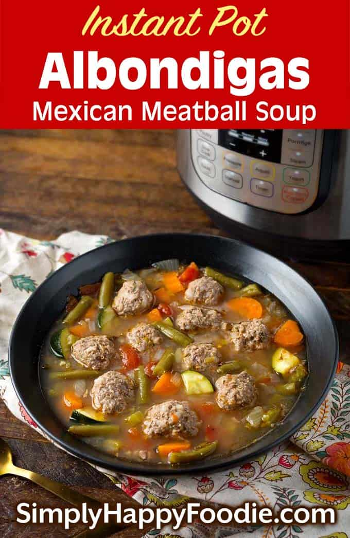 Instant Pot Albondigas Soup in black bowl in front of pressure cooker as well as title and Simply Happy Foodie.com logo