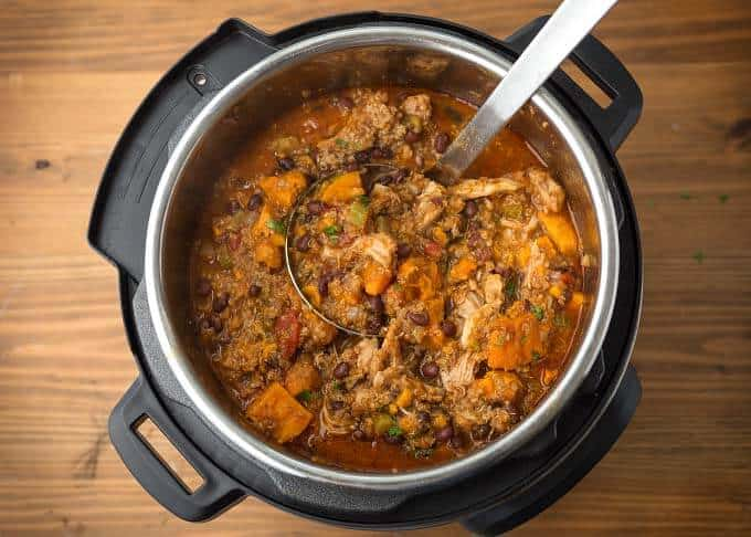 Sweet Potato Quinoa Chicken Chili in pressure cooker with ladle
