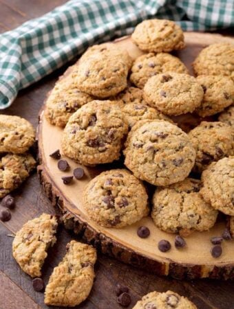 Several Chocolate Chip Oatmeal Cookies on round wooden board