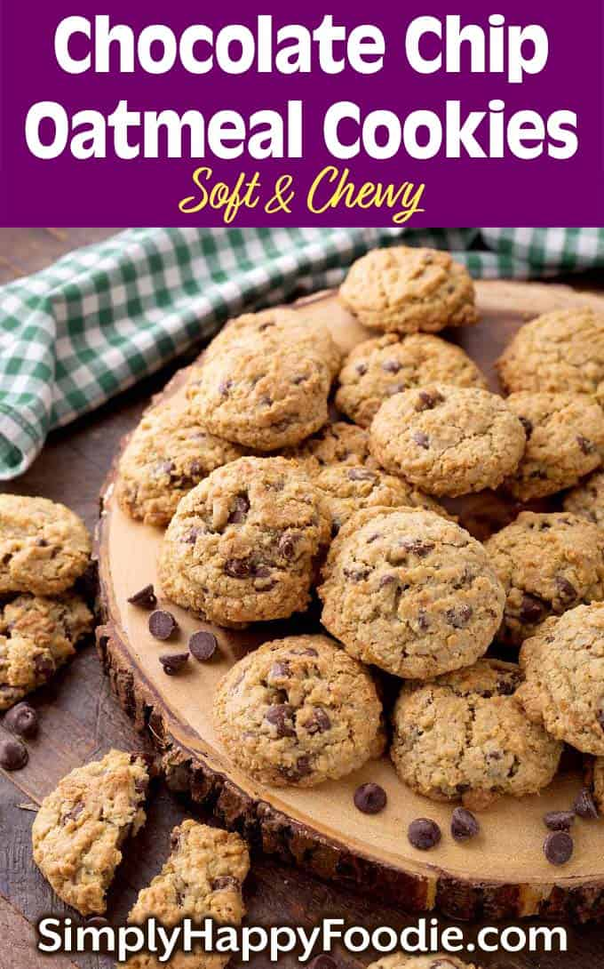 Several Chocolate Chip Oatmeal Cookies on round wooden board as well as title and Simply Happy Foodie.com logo