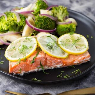 Instant Pot Lemon Butter Salmon and Vegetables on black plate