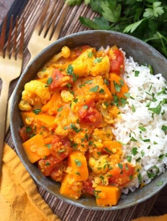 Instant Pot Red Curry Vegetables with rice in grey bowl