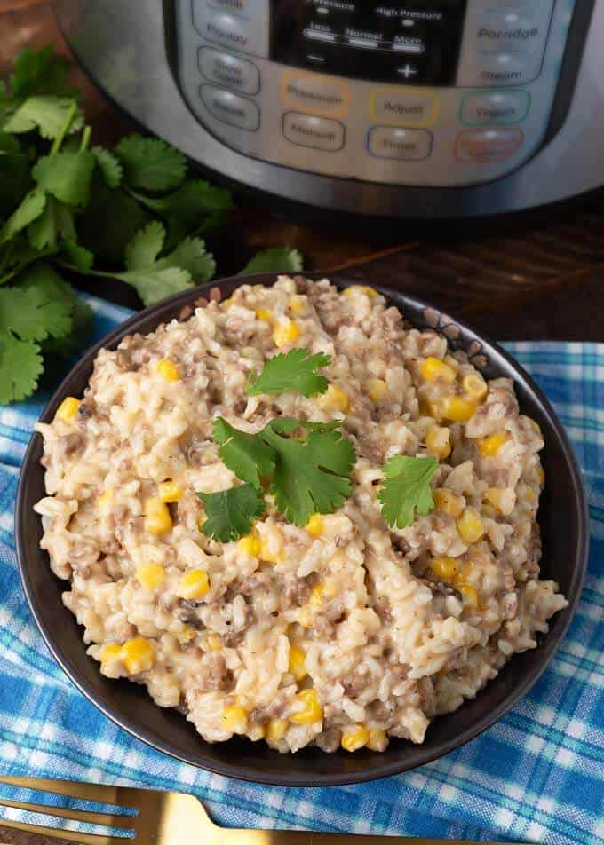 Pressure Cooker Cheesy Hamburger Rice Casserole on dark brown plate