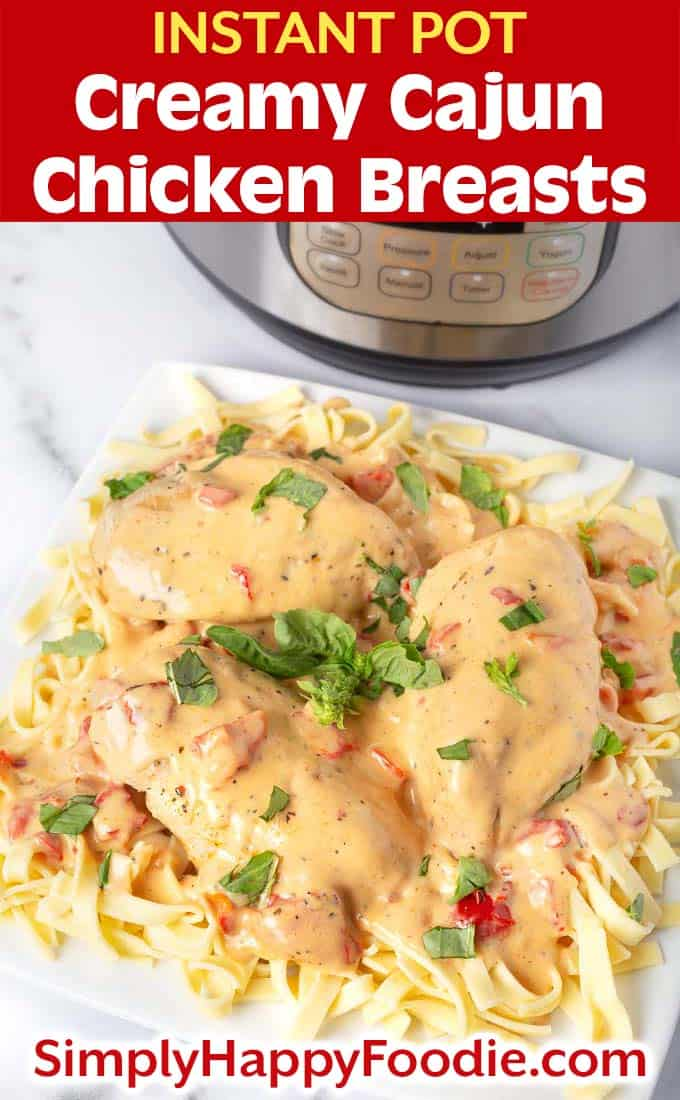 Instant Pot Creamy Cajun Chicken Breasts on white plate with title and simply happy foodie.com logo