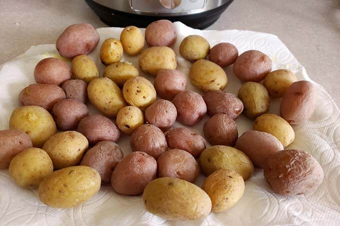 drying Instant Pot Syracuse Salt Potatoes on paper towels