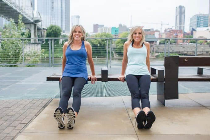 two women holding a workout pose