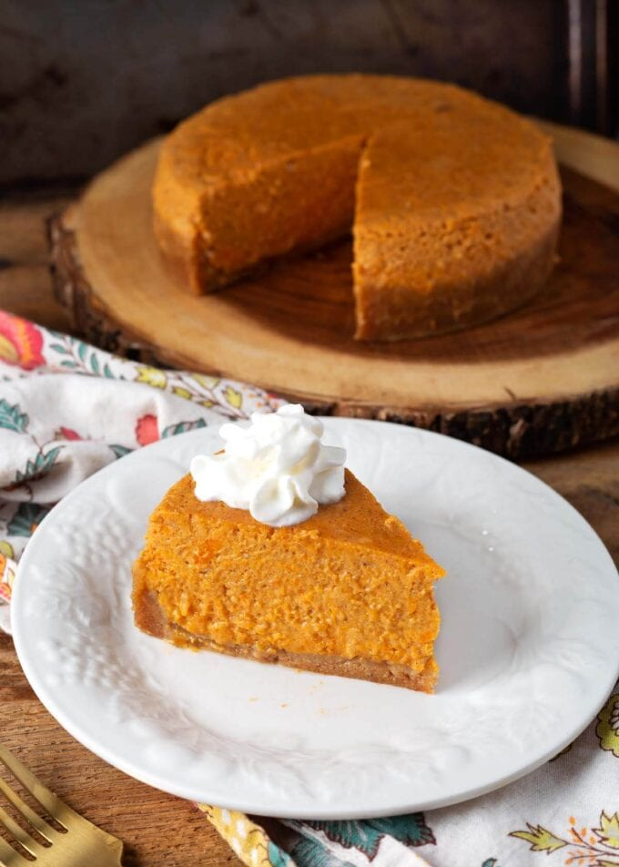 sweet potato pie on a white plate and a partial in background