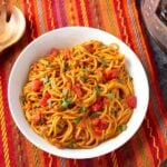 Instant Pot Taco Spaghetti in a white bowl on a red orange striped cloth