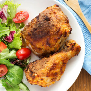 air fryer fried chicken on a white plate with salad