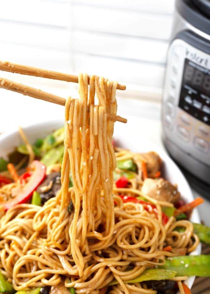 Lo Mein noodles on chopsticks