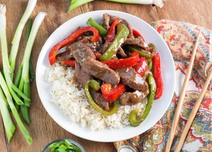 Instant Pot Pepper Steak on a white plate with wood background