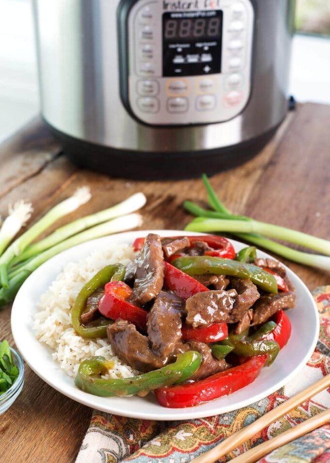 Instant Pot Pepper Steak on a white plate with IP in background