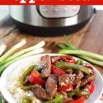 Instant Pot Pepper Steak on a white plate with Instant Pot in background