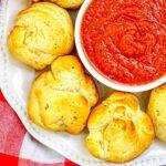 Air Fryer Mozzarella Balls close up with marinara sauce