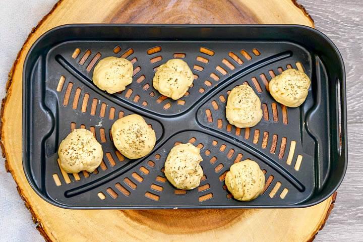 Air Fryer Mozzarella Balls on tray before air frying