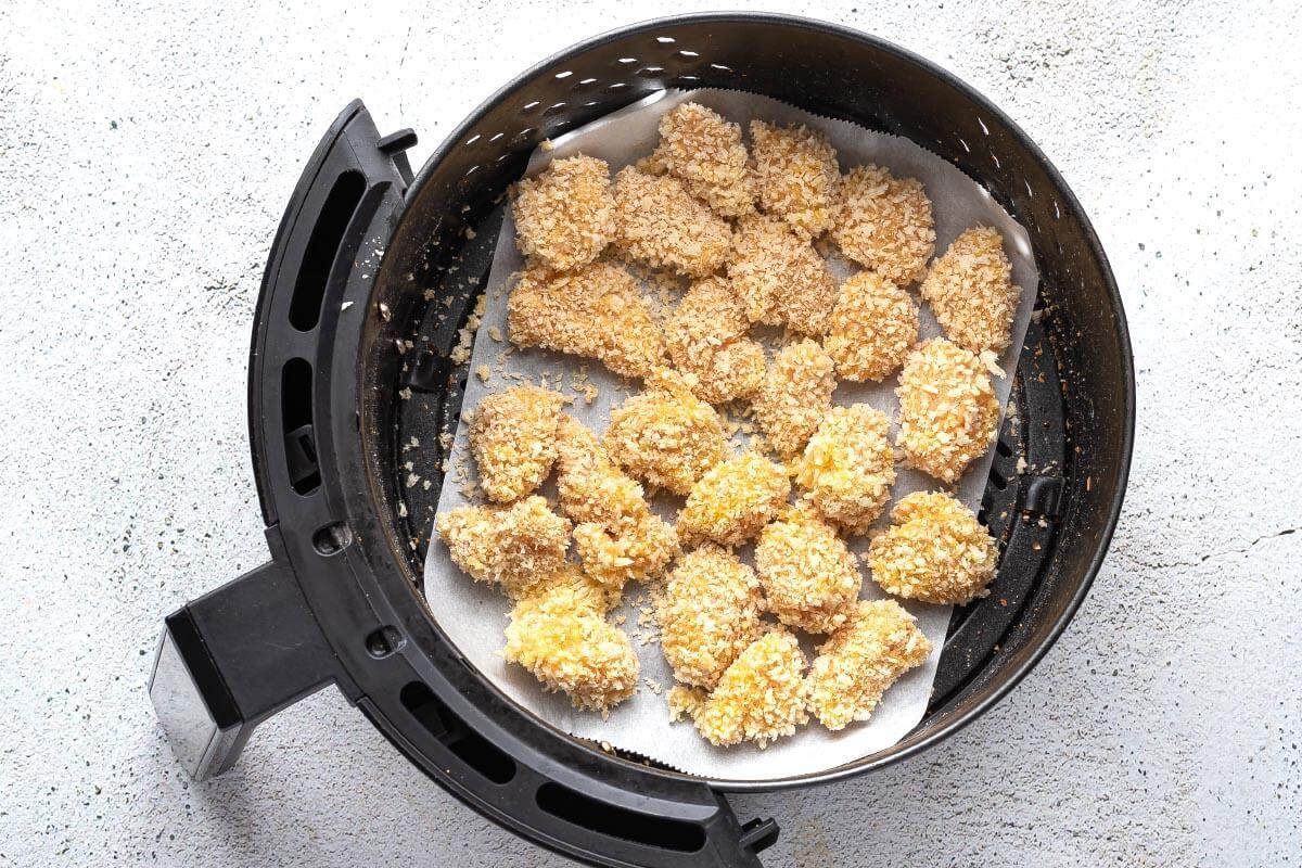 breaded chicken in air fryer basket