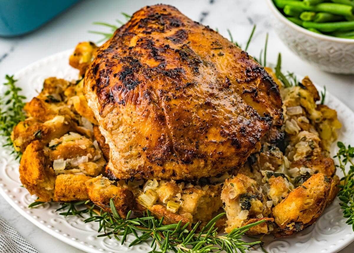 Air Fryer Turkey Breast on a white plate with stuffing