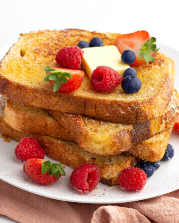 stack of french toast with berries